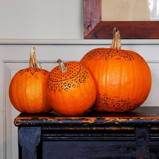 Use paper doilies to add a lace design to your pumpkins. Learn how here: http://www.bhg.com/halloween/pumpkin-decorating/stenciled-pumpkin/