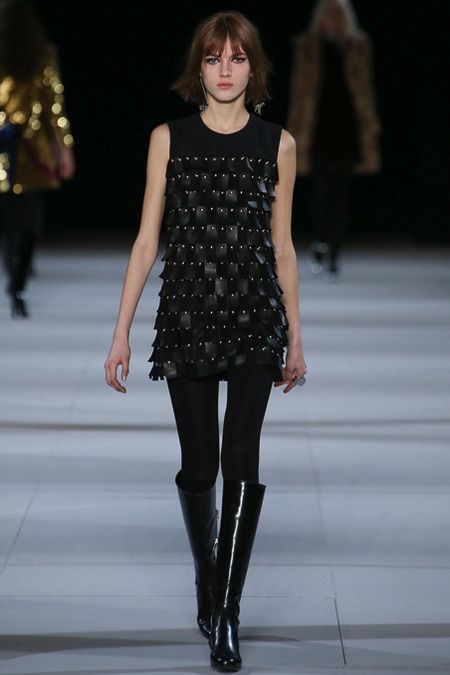 Black mini dress with rectangular leather appliques and studs by Saint Laurent. #IStyleNY #Style