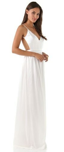 This long silk dress from ONE by Contrarian features a deep V neck ...
