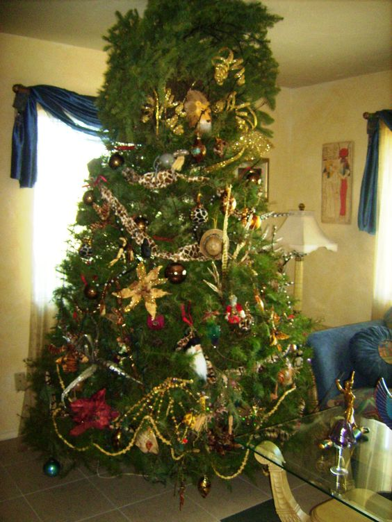 """The Safari Tree 2011.  They went through two trees (first one too short) and almost had to dump this one, but they got it upright and all of the """"stuff"""" on it.  Don't know how long it will last, but it is beautiful."""