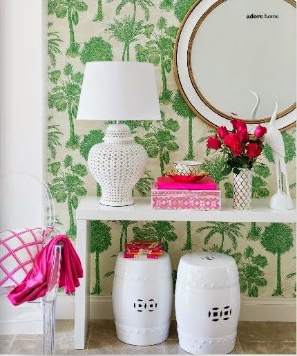 Large print green wallpaper, hot pink accessories, and blanc de chine accents look gorgeous together.: