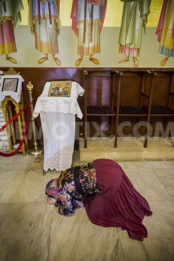 Prostrations are a part of Orthodox praxis (Russian Orthodox Christian Pilgrims visiting Jerusalem Israel):