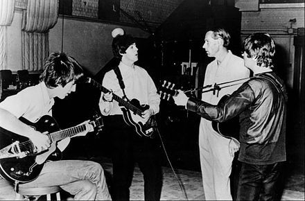 George Harrison, Paul McCartney, George Martin, and John Lennon