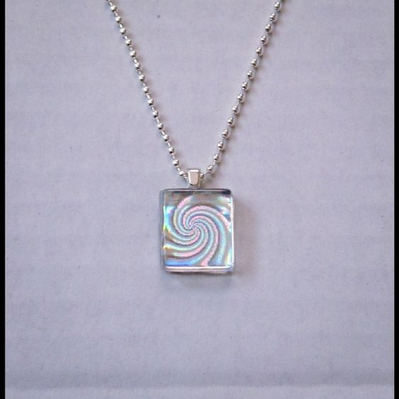 NWOT Holographic Swirl Necklace (Changes Color) Beautiful Holographic Swirl Necklace.  Changes color and appears to be spinning. So Cool!  Water Resistant.  Please remove before bathing. Custom Designed Jewelry Necklaces