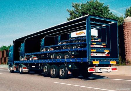 Truck Advertisement by Toxel. What's better than 1 semi full of Hot Wheels? 5, silly!: