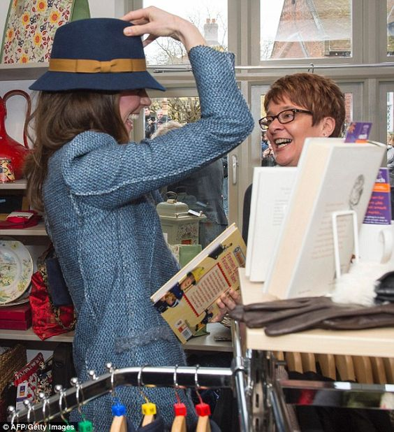 How do I look? Kate tries on a hat for size as she takes a look around the EACH charity shop: