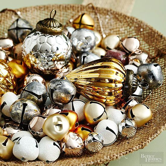 Add a festive jingle to your tabletop with a big bowl of silver and gold bells. We added a few coordinating ornaments for a change in scale.: