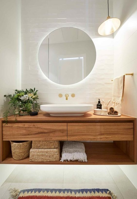 **Week 4, Main Bathroom** Hoping to replicate their success in the first ensuite reveal with their [main bathroom], Andy and Deb continued their relaxed neutral theme, pairing hand-made tiles with a timber vanity and gold tapware.