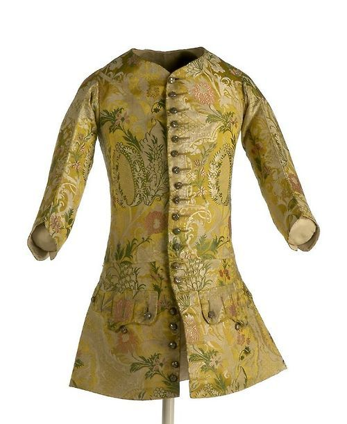 Long-sleeved waistcoat, c. 1730. Silk satin brocaded with flowers and scrolling leafs on golden yellow ground. Tumblr
