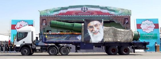 A military truck carrying a missile and a picture of Iran's Supreme Leader…