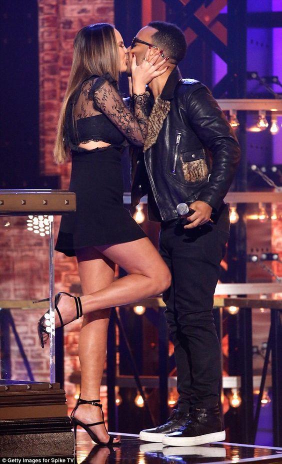 Crazy in love: Leggy Chrissy Teigen, 30, kissed her husband John Legend, 37, on the set of her Spike TV show Lip Sync Battle: All Stars Live on Sunday