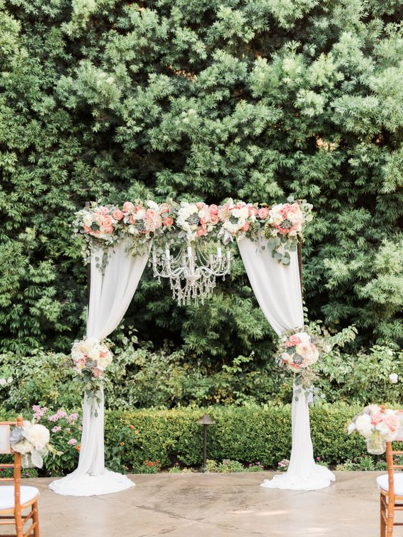 Wedding Ceremony Arch With Draping Fabric And Chandelier Succulents Roses Hydrangea