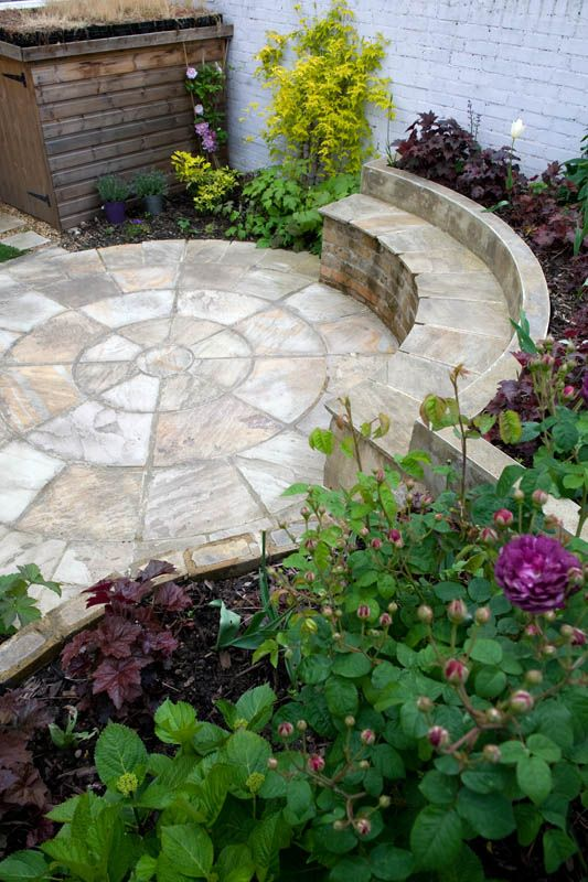 Flooring in the space will be on the form of an Indian sandstone circle measuring 3.6m in diameter. Asection of the outer ring will be elevated to form the a seat fronting a raised planting bed in the bottom left of the space. The existing walls will be rendered and painted and the fence panel mended.  #circle #sandstone #pavedcircle #courtyard