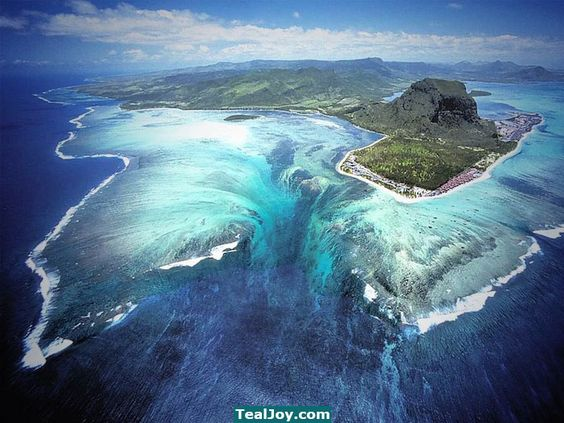 On the island of Mauritius, this sudden dip in ocean depth creates the illusion of an underwater waterfall. Description from twitter.com. I searched for this on bing.com/images
