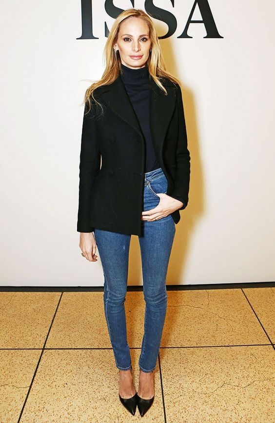 Lauren Santo Domingo in a black top, skinny jeans and pointed-toe heels.