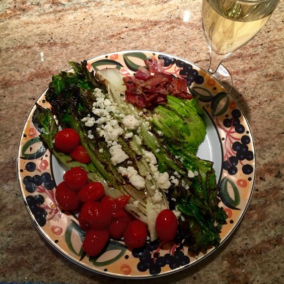Grilled romain (head cut in half, brushed w/ olive oil, 2 min ea side), roasted (or grilled) grape tomatoes, bacon, avocado, Gorgonzola, vinaigrette (olive oil, balsamic, Dijon)