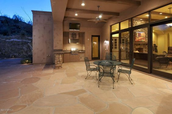 Contemporary Porch with Wrap around porch, Outdoor kitchen, Mushroom path & area light | low voltage landscape lighting