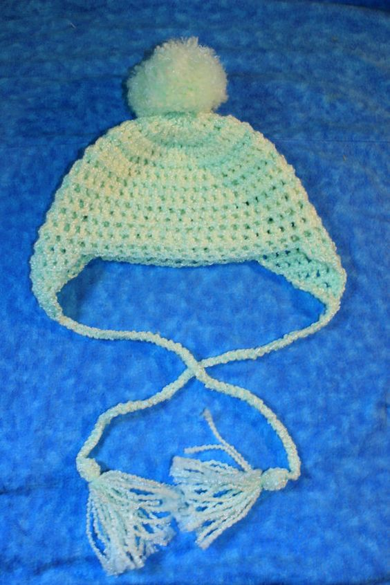 Neutral light yellow and green striped pom by JackintheBoxCrochet, $20.00