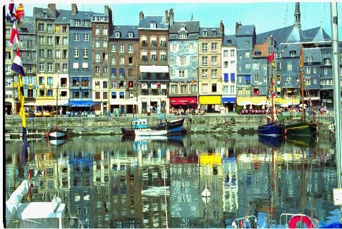 Honfleur is a gem near Paris and I always forget the name... I even bought a painting and when I got it home, I realized it was Honfleur. This harbor is frequently in art...