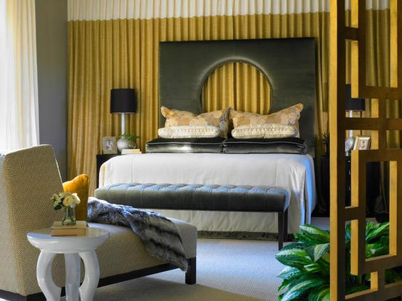 Bedroom with a gold behind the dark color head board. Do I like it?