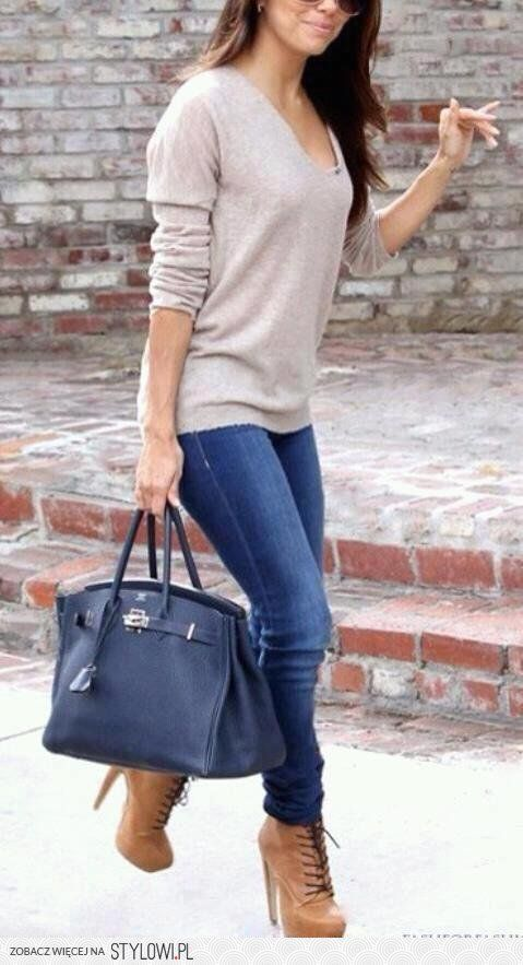 Boots, neutral sweater, and jeans.
