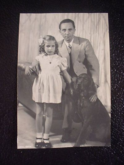A lovely picture of Dr. Paul Joseph Goebbels and his daughter Helga and the family pet