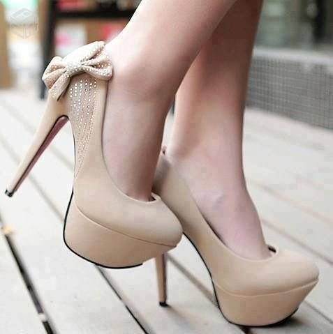 Heels, tan with cute bow Would be great with blue jeans & hot pink ...