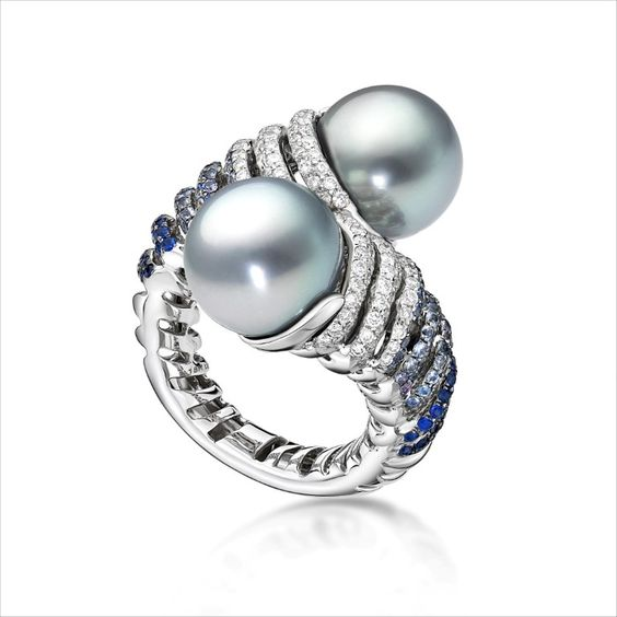 The Spira by BELPEARL. This dramatic bypass ring features two blue to grey Tahitian pearls on top of twisting rows of blue sapphire and white diamonds.