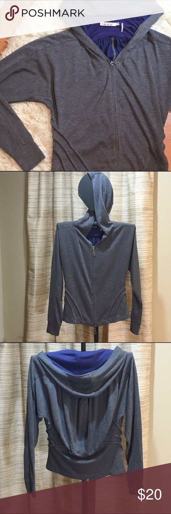 Flash sale! L.A.M.B. gray zip hoodie Super unique hoodie with navy lining and flowy back. It is in perfect condition and is perfect for those days you just want to wear a hoodie but still look stylish. L.A.M.B. Tops Sweatshirts & Hoodies