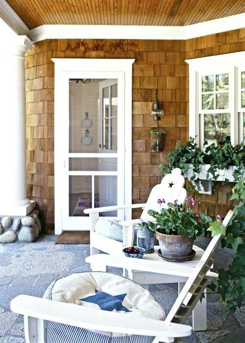 cedar shake, white trim, stone floor, river rock pillar base, light fixture