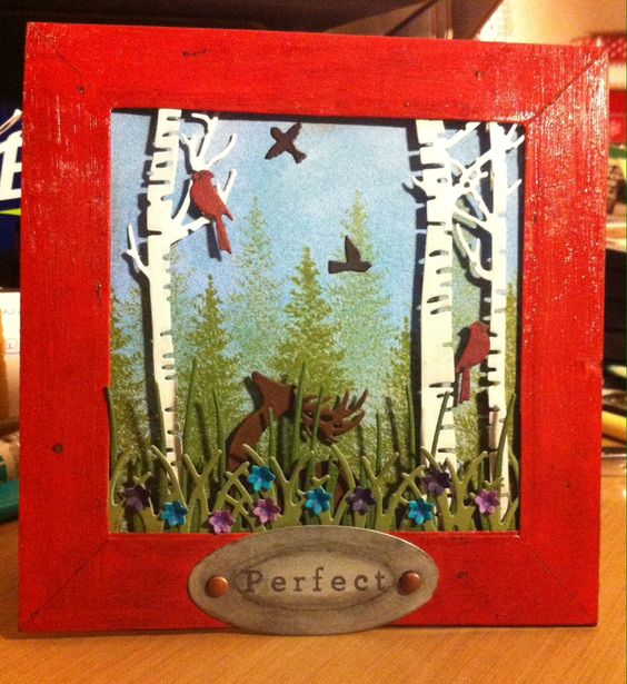Impression Obsession's grass and birch tree dies, Dee's Distinctively deer die, Memory Box's flying birds and flower mound and Poppy Stamp's grass border on a background of Impression Obsessions fir tree stamp surrounded by a Spellbinder's square cut frame and label. Inspired by Kittie Krafts beautiful Frame Cards and tutorials