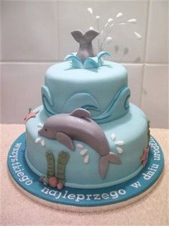 Dolphin Themed Cake by Cakes-by-Louise  Hannah wants dolphin and turtle decorations for her birthday party.