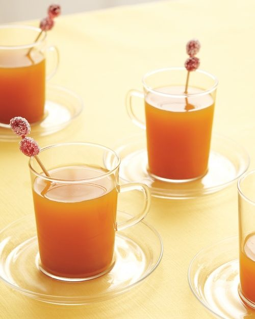 Hot apple cider garnished with sugared cranberries--the perfect fall cocktail