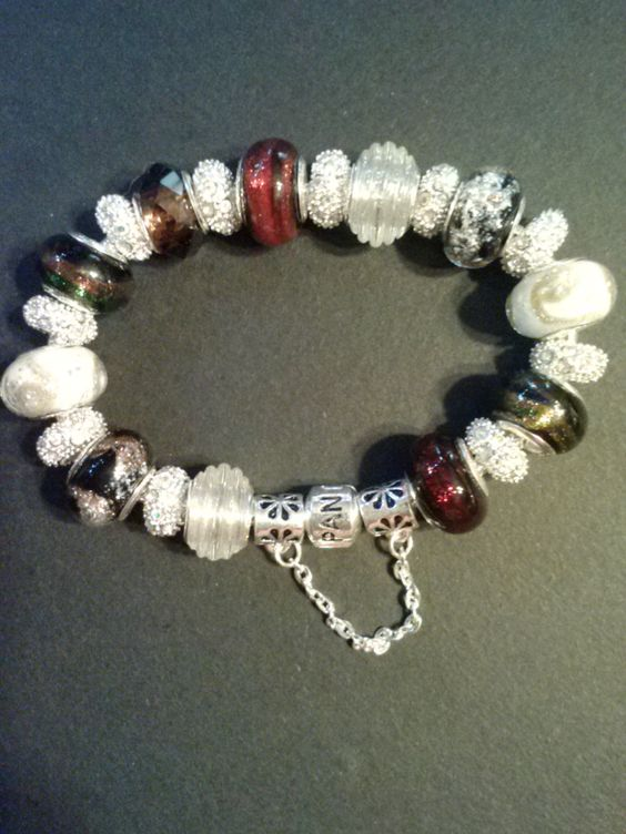 "Sterling Silver bracelet size 8"" with .925 glass murano beads and rhinestone crystal spacers."
