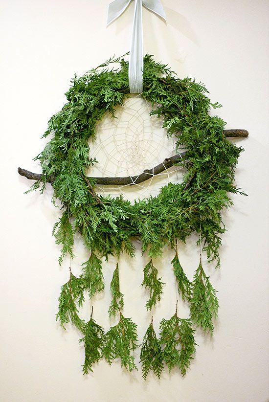 A cedar dream catcher wreath, created by Alex Cole (patchoulidesign.ca) and Natasa Kajganic (torontoflowermarket.ca)