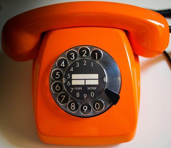 Vintage orange phone.: