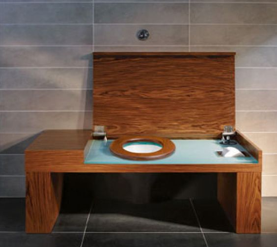 This toilet is hidden inside a beautiful walnut bench  Pretty sleek looking. This toilet is hidden inside a beautiful walnut bench  Pretty