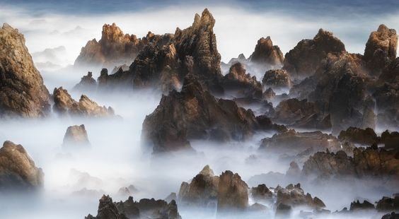 Invisible - Not seem to see the usual clouds, rough waves to hit the rocks. Dinosaur Ridge(mountains) to the sea. the rocks on the seashore in haesindang park.