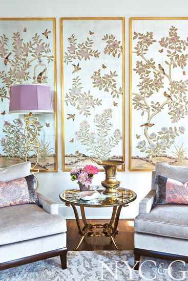 Framed Chinese handpainted wallpaper panels from #Gracie and a Niermann Weeks lamp dress up a corner of the living room in this tudor-style Syosset home | New York Cottages & Gardens | April 2014