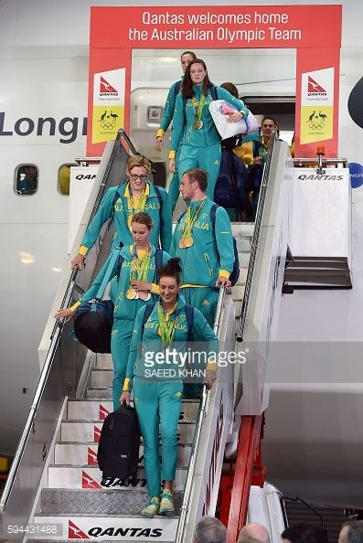 Australian members of Rio Olympic team come out of a plane during the welcome ceremony in Sydney on August 24 2016 Australia set aside squabbles over...