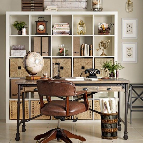 home office with vintage travel accessories explorer trend travel themed decorating photo