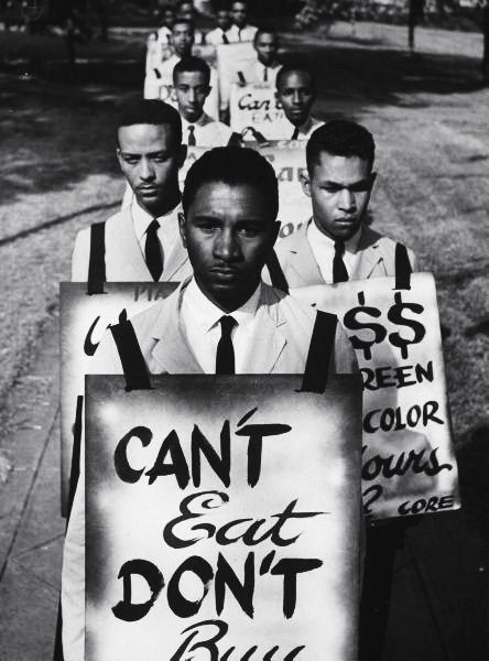 African-Americans on a picket line, protesting their treatment at a lunch counter. Photograph by Howard Sochurek. Petersburg, Virginia, USA, 1960.