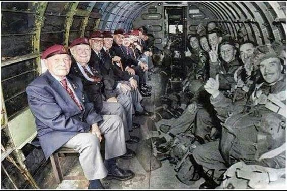 World War II paratroopers sitting across from themselves in the same plane that…