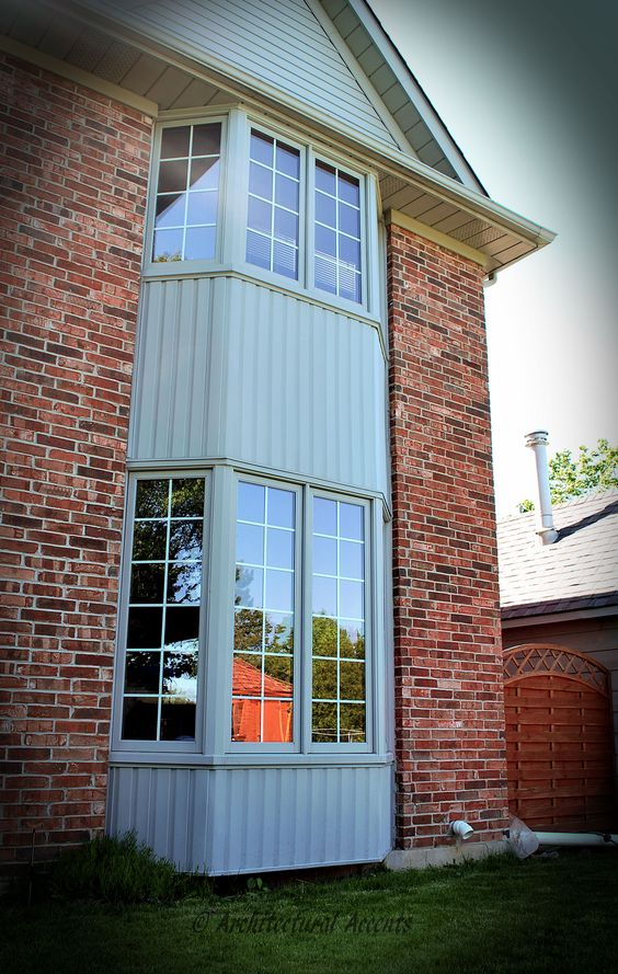 Gray siding pine and bays on pinterest for Wood clad windows