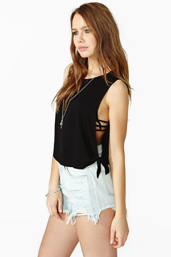 Tied Up Crop Tank: Rad black crop tank featuring a scoop neckline and tied open sides. Loose, boxy fit. Perfect paired with high-waist cutoffs and combat boots!