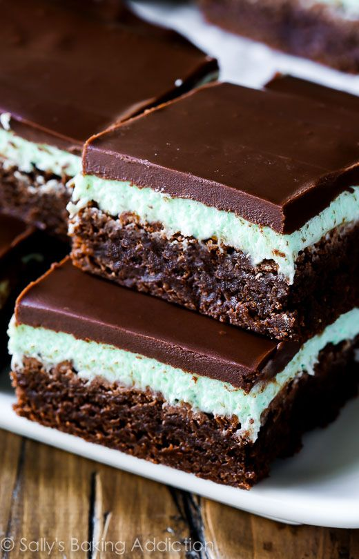 Thick and fudgy brownies layered with sweet mint frosting and easy chocolate ganache. These classic mint chocolate brownies will blow your mind; they're the best!: