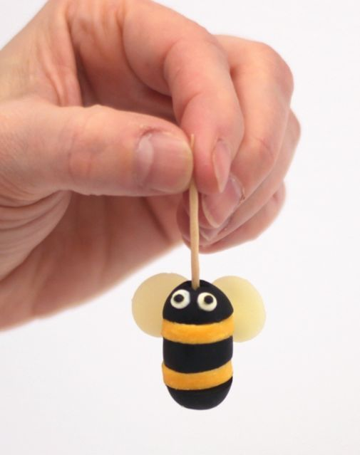 Adorably Easy and Cheesy - bumble bee body made from olives & cheese, wings are almond slices