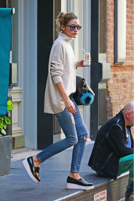 Olivia Palermo wears a turtleneck sweater with skinny jeans and black platform sneakers.: