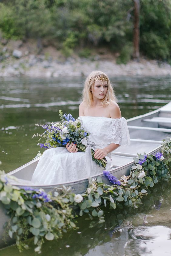 wedding canoe draped in a flower garland