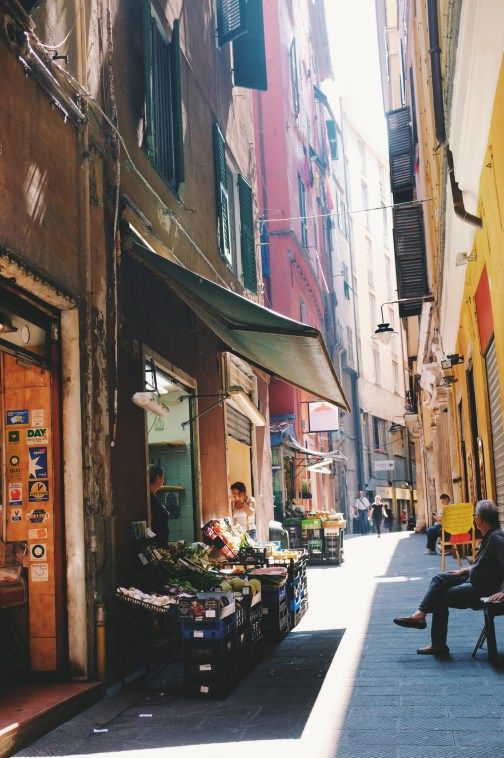 Genoa soon as I stepped outside of the train station in Genoa, everything exuded a whimsical charm. Petite fruit stands, focaccia shops, convenience store and locals sipping fresh coffee were all a part of the narrow path leading to my AirBnb destination